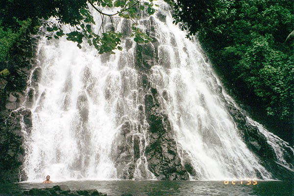 A man swimming in the waters at Kepirohi Waterfall. - Courtesy of tabisite.com
